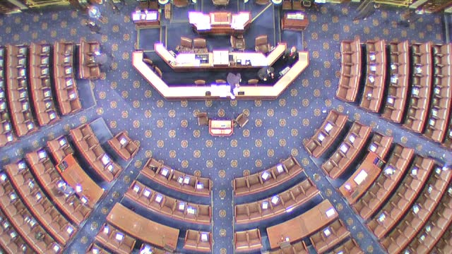 god's eye view down on floor of the house of representatives as workers clean tabletops, the dais and chairs in the chamber amid the coronavirus... - アメリカ合衆国下院点の映像素材/bロール