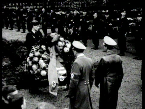 goebbels visits a cemetery where dutch and german soldiers are burried and lays a wreath at a memorial stone - place concerning death stock videos and b-roll footage