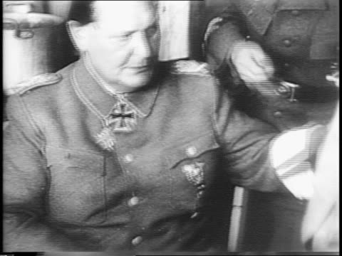goering seated and removes revolver / goering removes belt / goering without medals out of building / the press gathered / goering walking over to... - surrendering stock videos & royalty-free footage