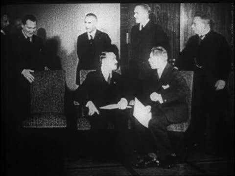 goering sitting next to hitler + vice chancellor von papen / hitler just became chancellor - 1933年点の映像素材/bロール