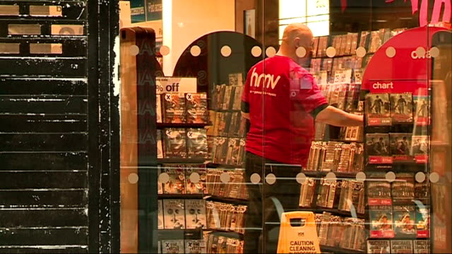 goes into administration: hmv oxford street store: hmv southampton store; southampton: ext staff inside store seen through glass doors / 25 percent... - dvd player stock videos & royalty-free footage