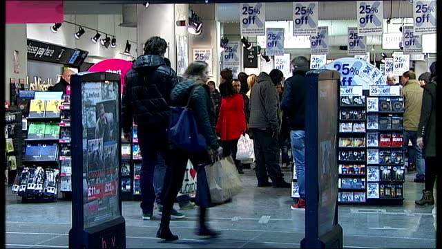 stockvideo's en b-roll-footage met potential buyers eye up business customers lookng at dvds in hmv store customers along in hmv store with sales signs above james curran interview sot - dvd