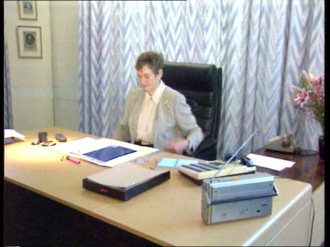 mi5 cms stella across room pan lr sits at desk john major speaking press sot ask stella rimington about the extent to which we're opening up mi5... - イギリス情報局保安部点の映像素材/bロール