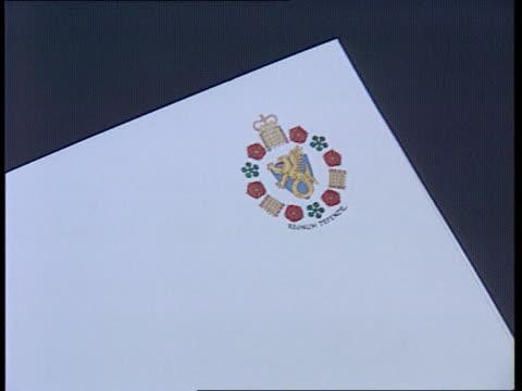 mi5 goes public int tcs mi5 crest on brochure as page turned - イギリス情報局保安部点の映像素材/bロール