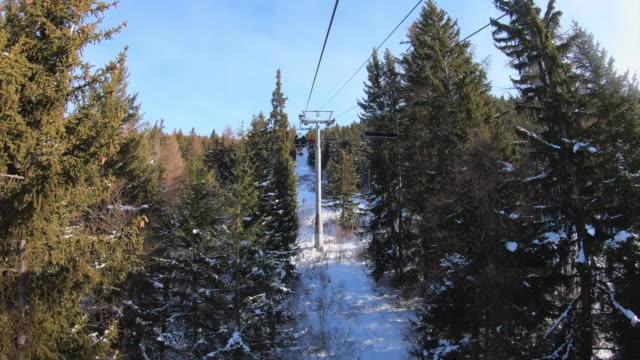 going down ski lift at les arcs ski resort - savoie, france - sunny video stock e b–roll