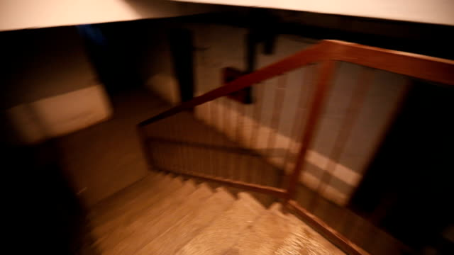 going down to spooky basement - staircase stock videos & royalty-free footage