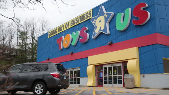 A Going Out Of Business sign hangs outside a Toys R Us Inc retail store in Frederick Maryland US on Monday April 16 2018