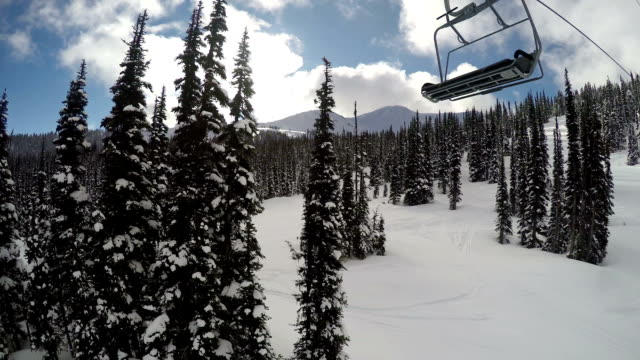 going up a chairlift at a ski resort - ski lift stock videos & royalty-free footage