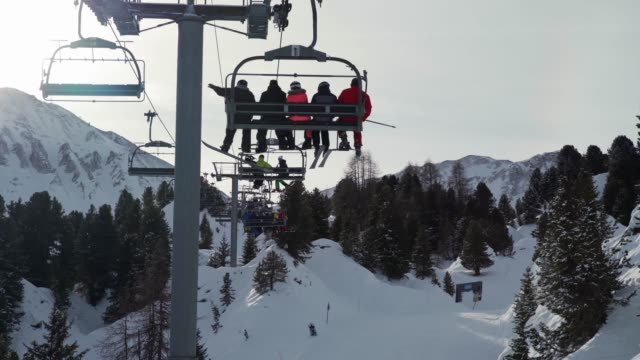going up the ski lift at la plagne ski resort, tarentaise, savoy, french alps, france, europe - winter sport stock videos & royalty-free footage
