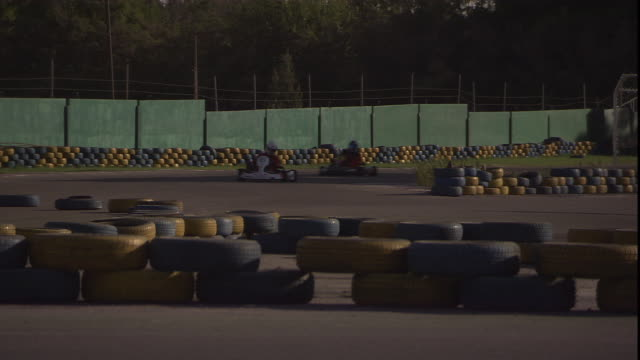 go-karts race around a track. - go cart stock videos & royalty-free footage