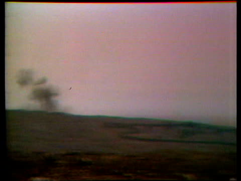 golan heights fighting israel syria border / israeli centurion tank towards shaky camera of shelling in distance m113 apc along shelled town... - arab israeli conflict stock videos & royalty-free footage
