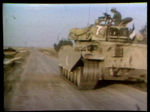 vídeos de stock, filmes e b-roll de golan heights fighting, israel, syria border / soldier unscrewing nose of shell, soldiers unloading shells from truck, centurion tank along,... - 1973