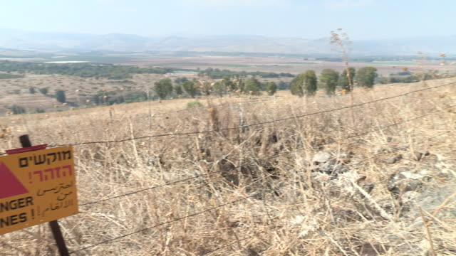 golan heights, israel - hazardous area sign stock videos & royalty-free footage