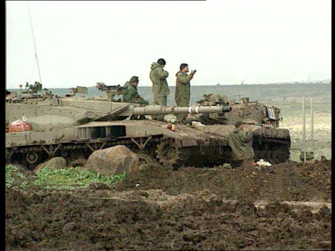 Israeli soldiers on lookout on tanks