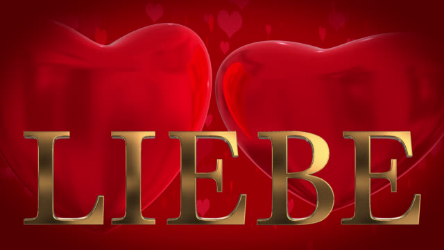 gold 3d german word liebe with moving heart shaped particles and two beating 3d hearts on a red background - liebe stock videos & royalty-free footage