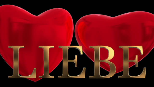 gold 3d german word liebe with two beating 3d red hearts saved with alpha channel - liebe stock videos & royalty-free footage