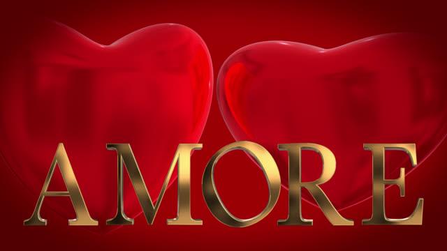 Goud 3D Italiaanse woord Amore met twee 3D rode harten gewonnen op een rode achtergrond