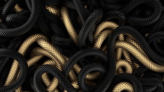 vidéos et rushes de fond abstrait d'or et noir des courbes couvertes des échelles - corde