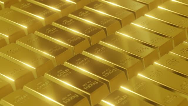 vidéos et rushes de modèle de lingots d'or tournant avec la lumière brillante - pierre précieuse