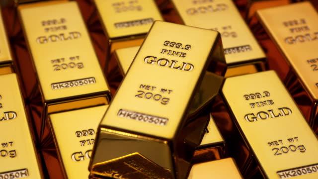 vídeos y material grabado en eventos de stock de barras de oro - oro