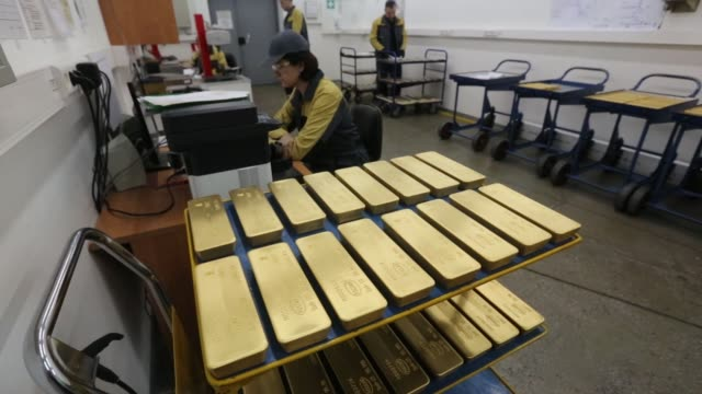 gold bars with engraved marks to identify the purity content the year of manufacture and the country of origin engraved sit on a trolley ahead of... - ingot stock videos & royalty-free footage