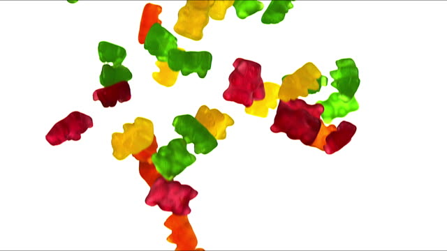 """gold bears or gummy bears falling against white background, slow motion"" - confectionery stock videos & royalty-free footage"