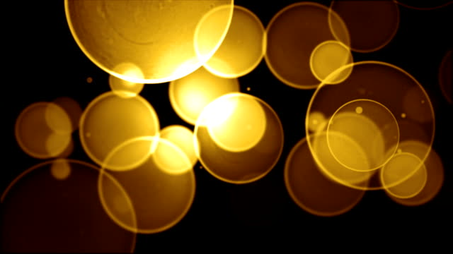 gold bokeh background video loop (full hd) - yellow background stock videos & royalty-free footage