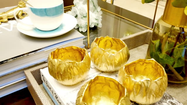 gold bowls in luxury living room