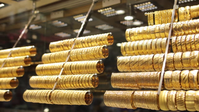 gold bracelets in shop - gold coloured stock videos & royalty-free footage