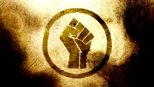 Gold brown raised fist symbol on high contrasted grungy and dirty, animated, distressed and smudged 4k video background with swirls and frame by frame motion feel with street style for the concepts of solidarity,support,human rights,worker rights,strength