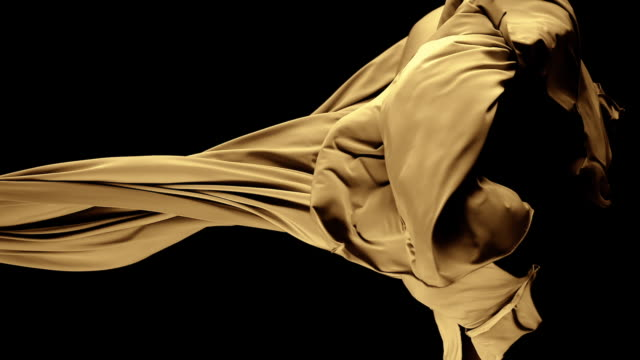 gold/ brown silky fabric flowing by wind in black background, slow motion - textile stock-videos und b-roll-filmmaterial