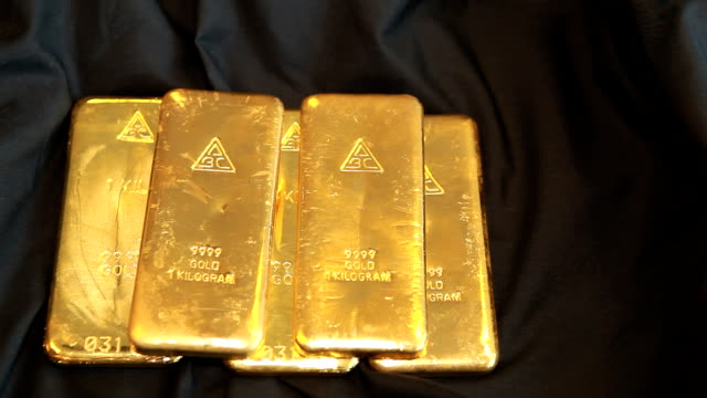 gold bullion stack time lapse - ingot stock videos and b-roll footage