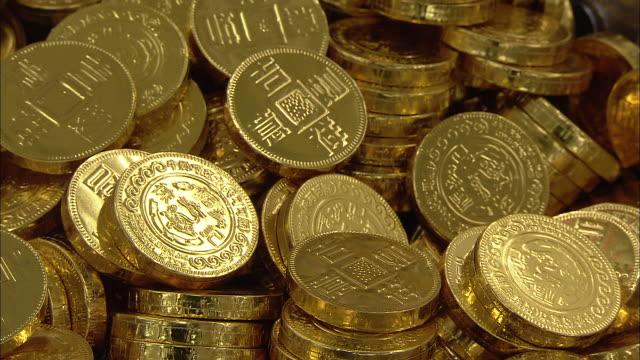 Gold candy coins gleam in a bin.
