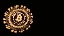 Gold circular hologram rotating bitcoin sign
