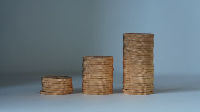 gold coin stop motion animation - wages stock videos & royalty-free footage