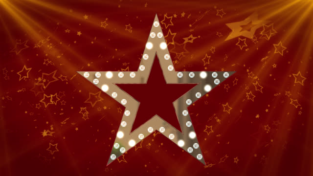 3D gold coloured star with flashing lights and cascading star shapes