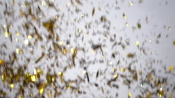 Gold confetti explosion on white background