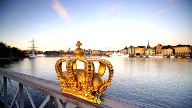 gold crown on skeppsholmen bridge in stockholm city - crown headwear stock videos & royalty-free footage