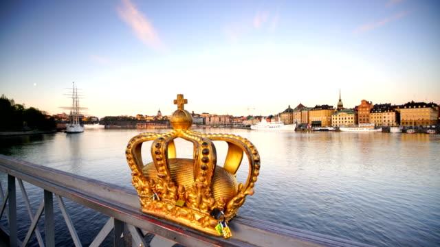 gold crown on skeppsholmen bridge in stockholm city - royalty stock videos & royalty-free footage