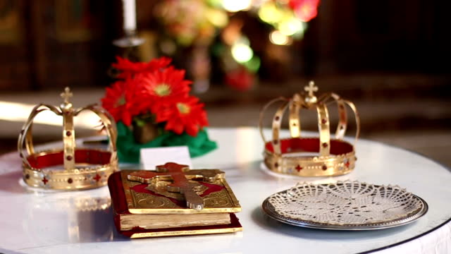 Gold crowns for wedding and Bible