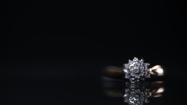 gold diamond engagement ring on dark background - intricacy stock videos & royalty-free footage