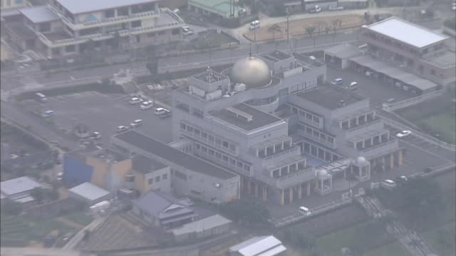 A gold dome highlights the Amagi Town Office on Tokunoshima Island in Japan.