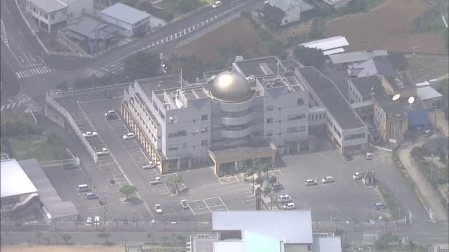 A gold dome tops the Amagi Town Office on Tokunoshima Island, Japan.