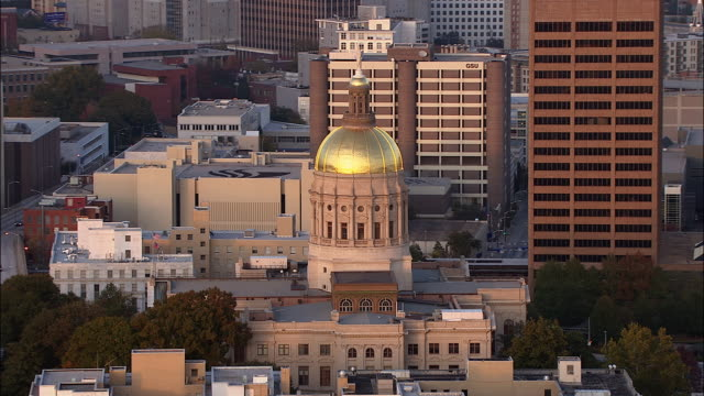 a gold dome tops the capitol building in downtown atlanta, georgia. - atlanta georgia stock videos & royalty-free footage