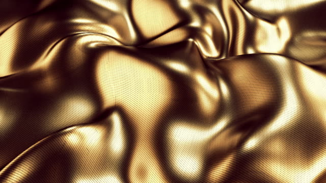 gold fabric creates a wave motion beautiful background - amber stock videos & royalty-free footage