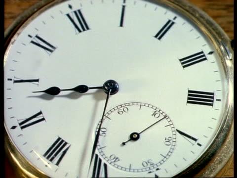 t/l bcu gold half hunter pocket watch, white watch face, black roman numerals - pocket watch stock videos & royalty-free footage