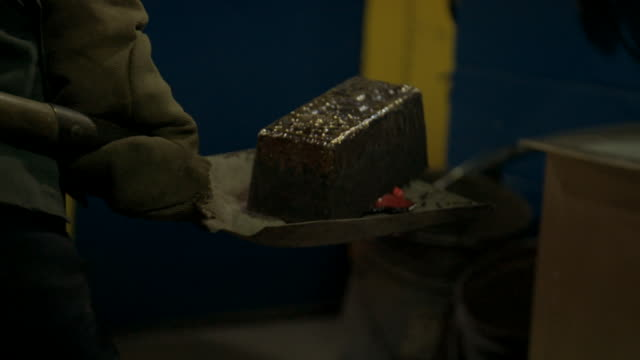 gold ingot is carried in shovel and cooled in water - mining stock videos & royalty-free footage