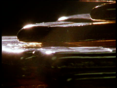 gold ingots rotate on display shimmering in the light - lingotto video stock e b–roll