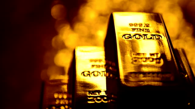 serie: gold ingots - gold colored stock-videos und b-roll-filmmaterial