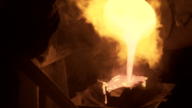 gold is pored from smelter until it overflows - metal industry stock videos & royalty-free footage